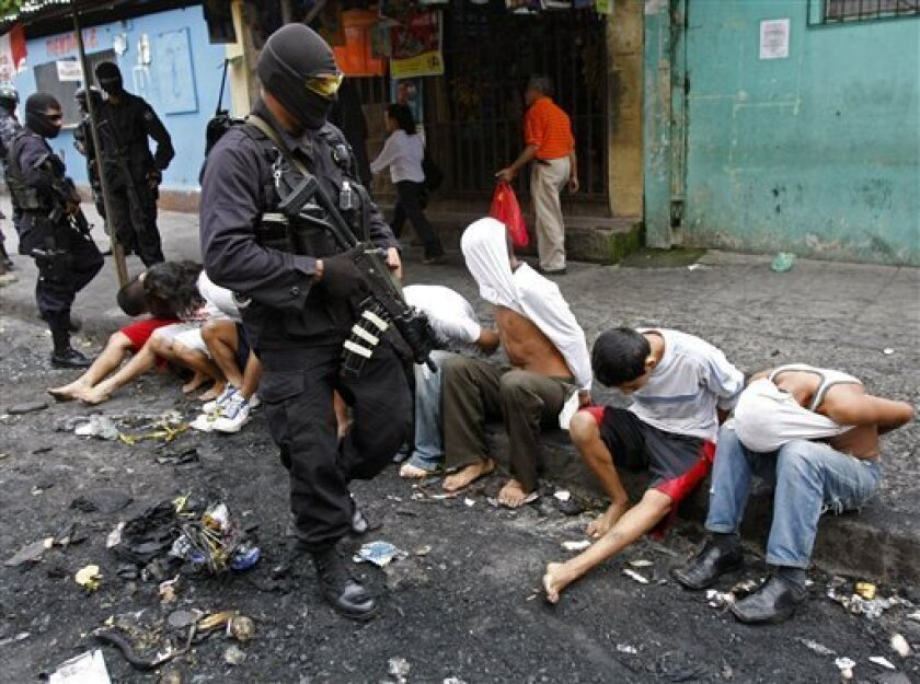 Police present to the press eight suspects in connection with the burning of a bus that killed 14 after detaining them in San Salvador, Monday, June 21, 2010.  Gang members opened fire on a bus full of travelers on Sunday night, doused it with gasoline and set it on fire, killing at least 14 on the