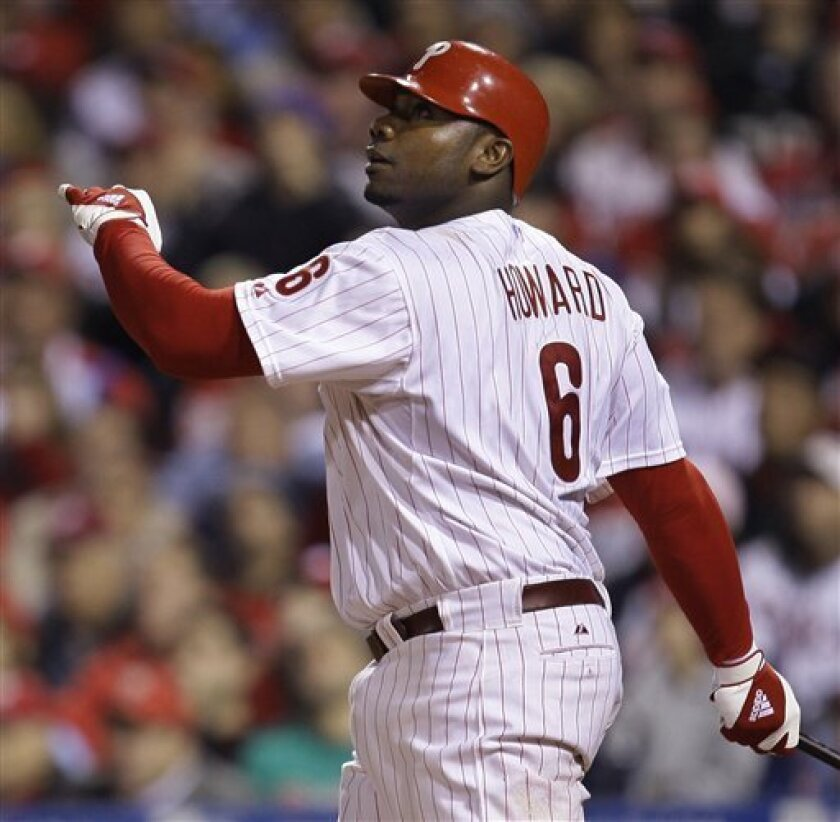 In this Oct. 26, 2008 file photo, Philadelphia Phillies' Ryan Howard watches his three-run home during the fourth inning of Game 4 of the baseball World Series against the Tampa Bay Rays in Philadelphia. Howard has agreed to a $54 million, three-year contract with the Philadelphia Phillies Sunday, Feb. 8, 2009, avoiding a potentially contentious arbitration hearing. (AP Photo/Chris O'Meara, File)