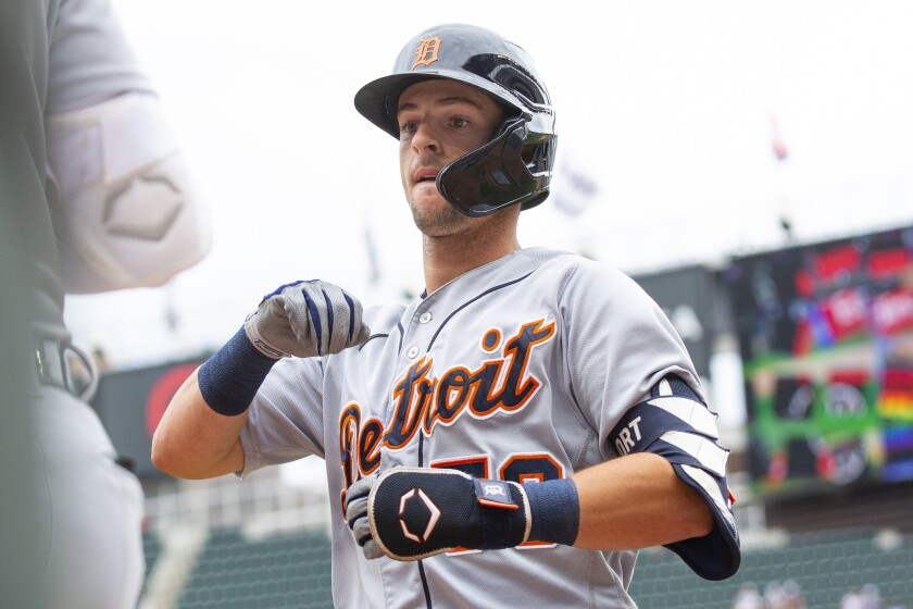 Detroit Tigers shortstop Zack Short is congratulated after hitting a home run against the Minnesota Twins in the first inning of a baseball game, Saturday, July 10, 2021, in Minneapolis. (AP Photo/Andy Clayton-King)
