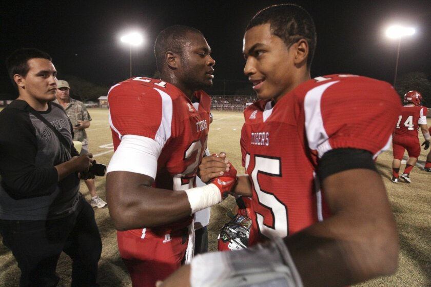 Imperial's Royce Freeman is congratulated by teammate Chris Carter after Freeman broke the San Diego Section career rushing record.
