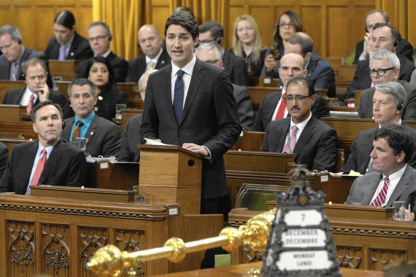 Canadian Prime Minister Justin Trudeau speaks in the House of Commons. A law requiring official communications to be made in both English and French was adopted 46 years ago by his father, former Prime Minister Pierre Trudeau.