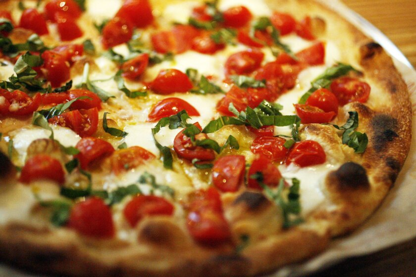 """A 3-D food """"printer"""" could print out a pizza using various powders and oils, though it might not look quite like this."""