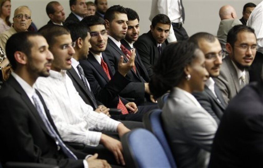 Some of the so-called, Irvine 11, men who are accused of disrupting a speech by the Israeli ambassador to the U.S. at the University of California, at Irvine, await opening statements in their trial in Santa Ana, Calif., Wednesday, Sept. 7, 2011. Charges are slated to be dismissed against co-defendant Hakim Nasreddine Kebir as long as he completes 40 hours of community service by next month. The other defendants are Mohamad Mohy-Eldeen Abdelgany, Khalid Gahgat Akari, Aslam Abbasi Akhtar, Joseph Tamim Haider, Taher Mutaz Herzallah, Shaheen Waleed Nassar, Mohammad Uns Qureashi, Ali Mohammad Sayeed, Osama Ahmen Shabaik, and Asaad Mohamedidris Traina. (AP Photo/Alex Gallardo)