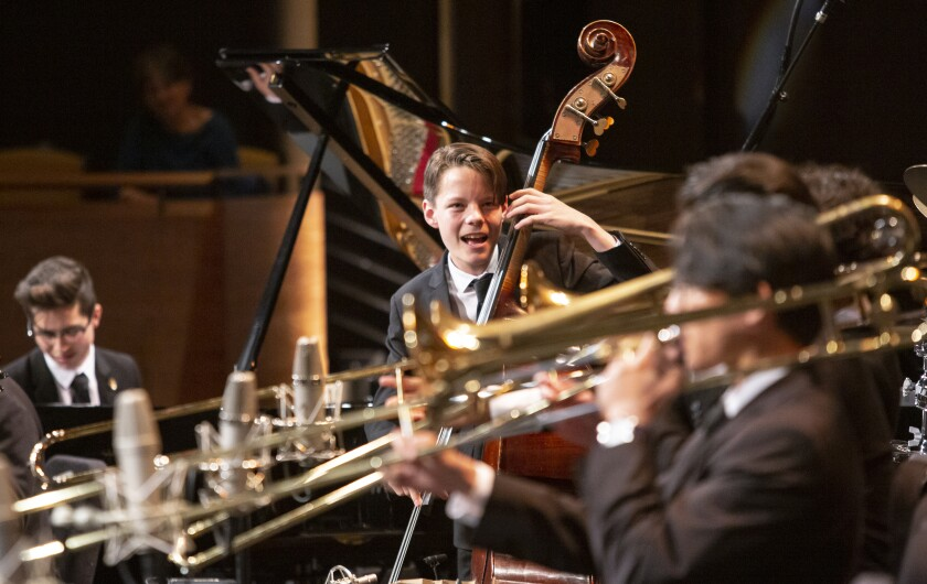 San Diego's John Murray (center) became the first bassist to ever win Outstanding Soloist honors at Jazz at Lincoln Center's 24-year-old Essentially Ellington High School Jazz Band Competition & Festival in New York. Murray celebrated his 15th birthday on March 12.