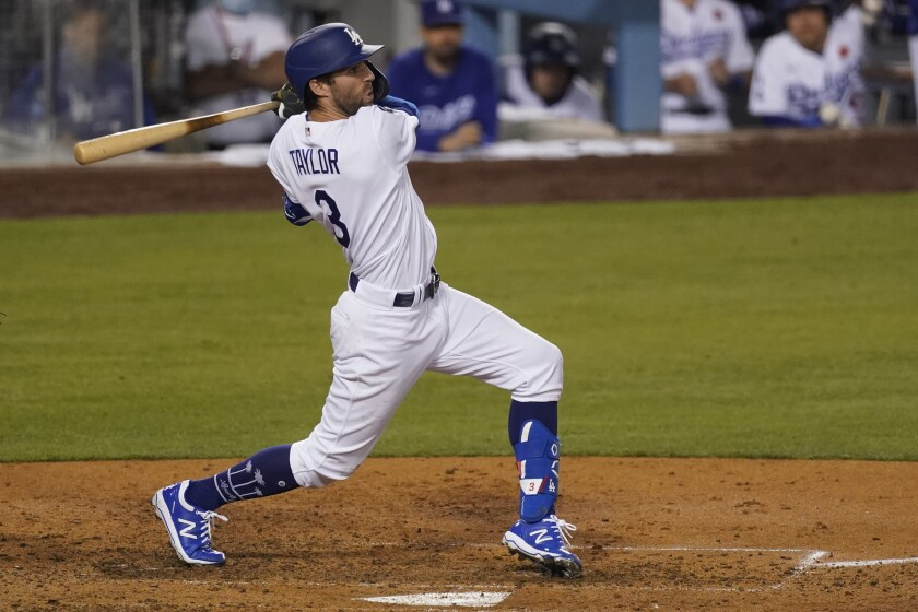 Chris Taylor hits a 14th-pitch, bases-clearing double in the sixth inning for the Dodgers.