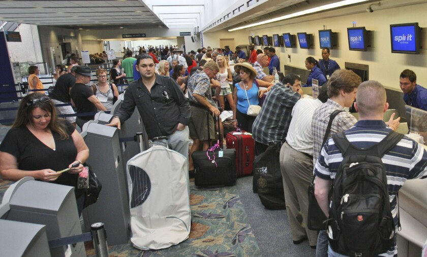 Passengers line up at the Spirit Airlines counter at Fort Lauderdale-Hollywood International Airport in Fort Lauderdale, Fla., on Friday, June 11, 2010. The complaint rate for Spirit Airlines was about six times higher than the average rate for the nation's airlines in 2015.