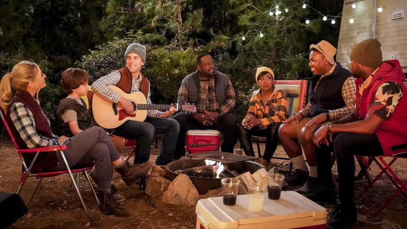 """Beth Behrs, left, Hank Greenspan, Max Greenfield, Cedric the Entertainer, Tichina Arnold, Marcel Spears and Sheaun McKinney in """"The Neighborhood"""" on CBS."""