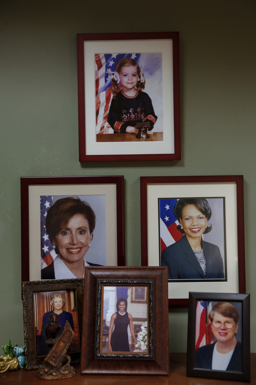 "Female leaders line the office walls of Leslie Knope on ""Parks and Recreation."""