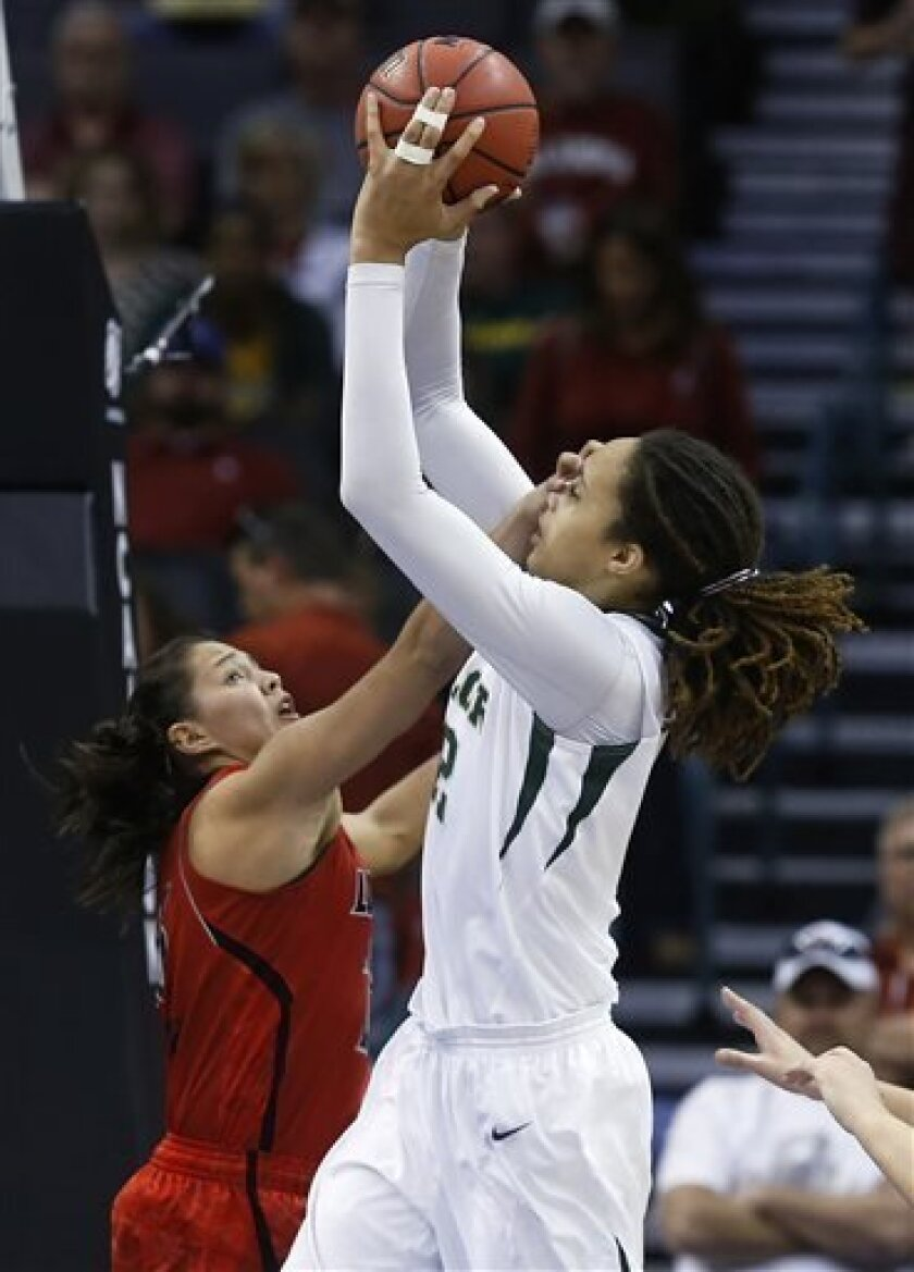 Baylor 's Brittney Griner (42) shoots as Louisville guard Shoni Schimmel (23) defends in the first half of a regional semifinal game in the women's NCAA college basketball tournament in Oklahoma City, Sunday, March 31, 2013. (AP Photo/Sue Ogrocki)