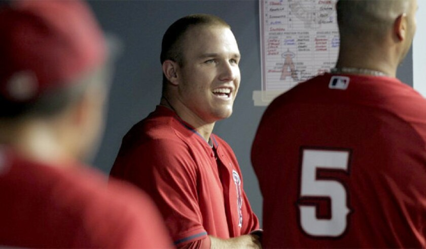 Mike Trout and the Angels agreed on a six-year contract extension Friday worth $144.5 million.