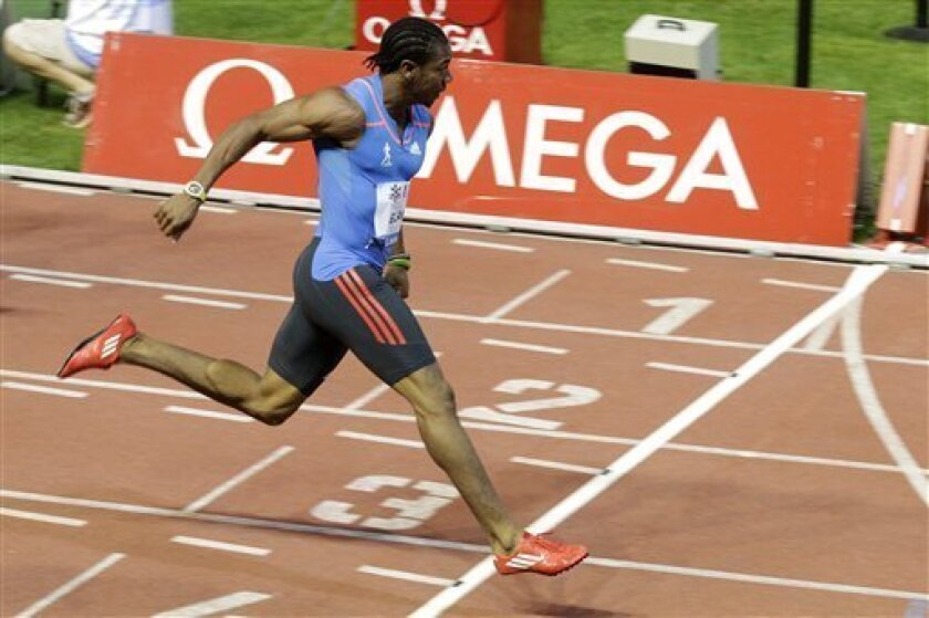 Yohan Blake from Jamaica crosses the line to win the men's 100-meter race, at the Athletissima Diamond League Athletics Meeting in Lausanne, Switzerland, Thursday, Aug. 23, 2012. (AP Photo/Keystone, Salvatore Di Nolfi)