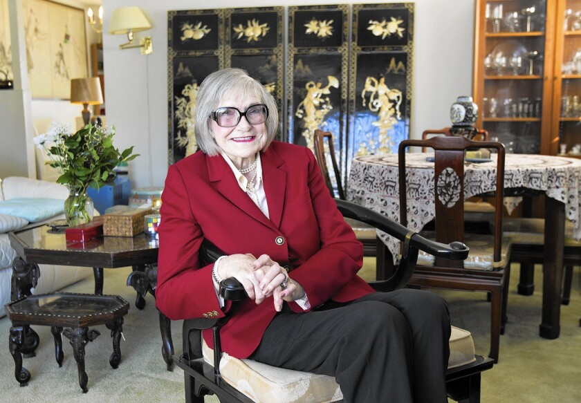 Irene Jewell, aka Ricki Covette, is pictured in her Costa Mesa home in December 2014. At 6-foot-8, she headlined clubs from the 1950s through 1970s as the world's tallest burlesque dancer. She died Friday at age 90.