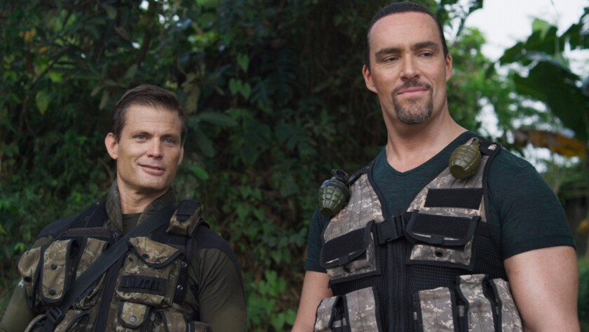 "Casper Van Dien, left, and Alexander Nevsky in the movie ""Showdown in Manila."""