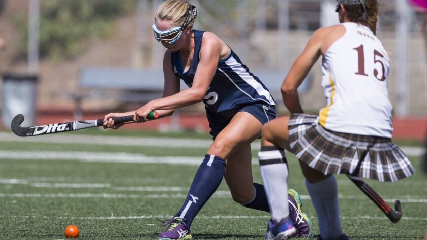 Scripps Ranch's Megan Connors takes a shot around Serra's Kathryn Peterson.