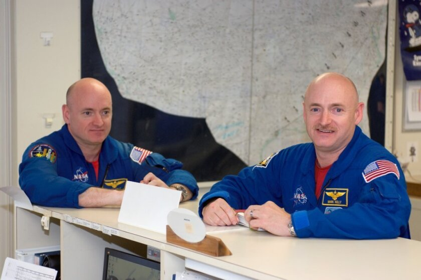 Astronauts and identical twins Mark Kelly (right) and Scott Kelly (left) will participate in 10 experiments while Scott is in space and Mark is on Earth.