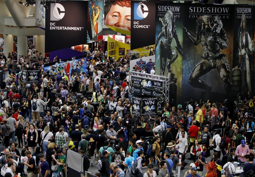 The massive, sold-out crowd navigates the San Diego Convention Center Crowds on Day 3 of last year's Comic-Con in downtown San Diego. Eduardo Contreras U-T file photo
