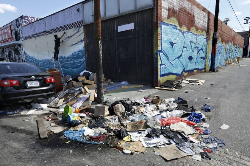 A pile of trash sits uncollected on Santee St. in between 18th St