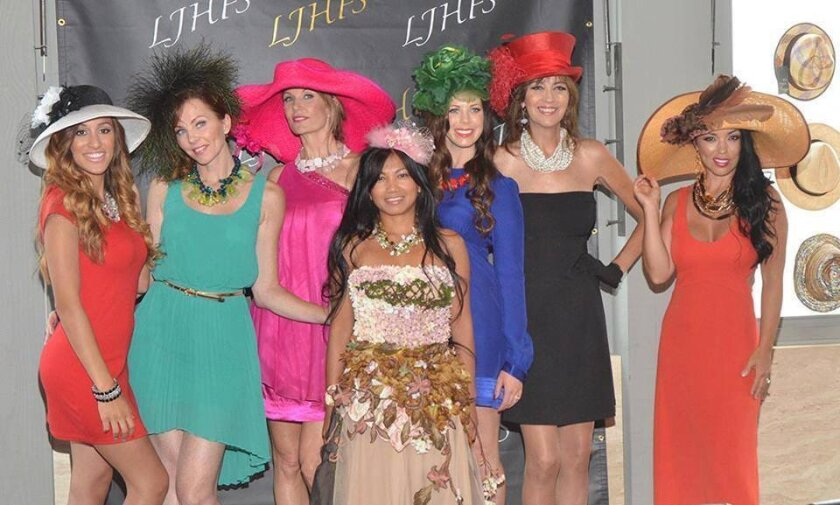 Event organizer Mary Soriano (front and center) with models from the 2013 La Jolla Hat Show.