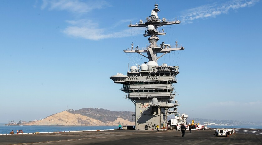 The Carl Vinson, with Point Loma in the background (left), is seen here as the aircraft carrier heads out to sea for a training mission in October.