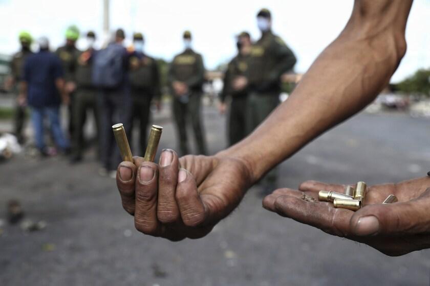 Man holding bullet casings