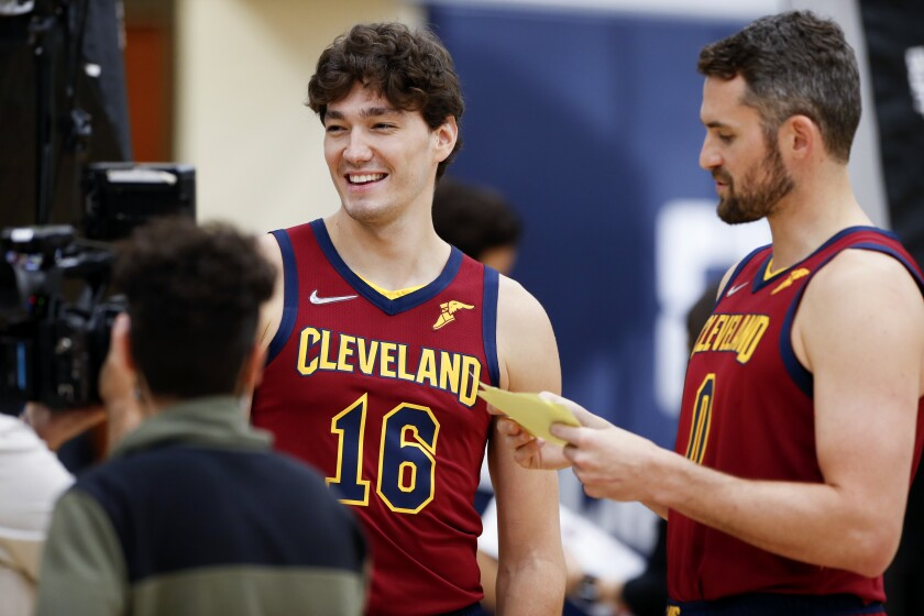 Cleveland Cavaliers' Kevin Love (0) interviews Cedi Osman (16) during the NBA basketball team's media day, Monday, Sept. 27, 2021, in Independence, Ohio. (AP Photo/Ron Schwane)
