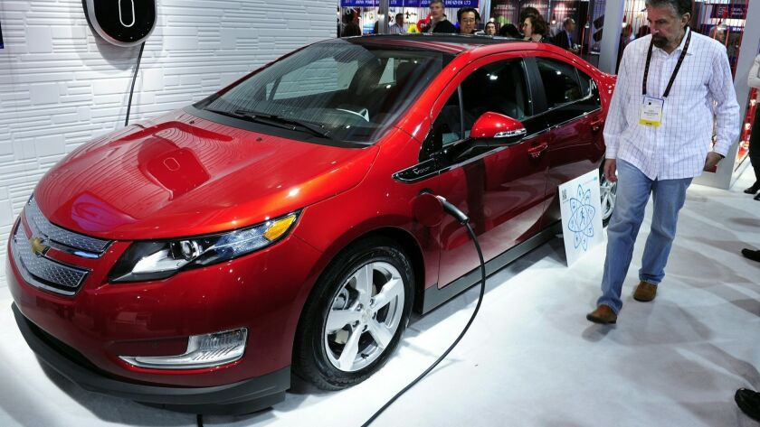 A Chevrolet Volt hybrid-electric car is plugged into GE's Residential WattStation at the 2011 International Consumer Electronics Show. General Motors Co. said Monday that it will scrap the Volt, considered the future of the company when it hit the road in 2010.
