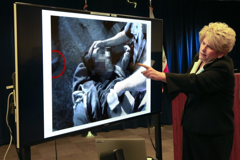 San Diego District Attorney Bonnie Dumanis in December 2015 points to the video to where San Diego Police officer, Neal Browder is giving first aid toFridoon Nehad immediately after he shot him.