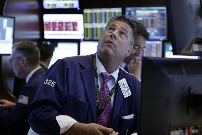 Trader William McInerney works on the floor of the New York Stock Exchange, Monday, Aug. 24, 2015. U.S. investors woke up to a serious jolt Monday when the Dow Jones industrial average tumbled 1,000 points minutes after the market opened in a wave of selling that circled the globe after a historic plunge in Chinese stocks. (AP Photo/Richard Drew)