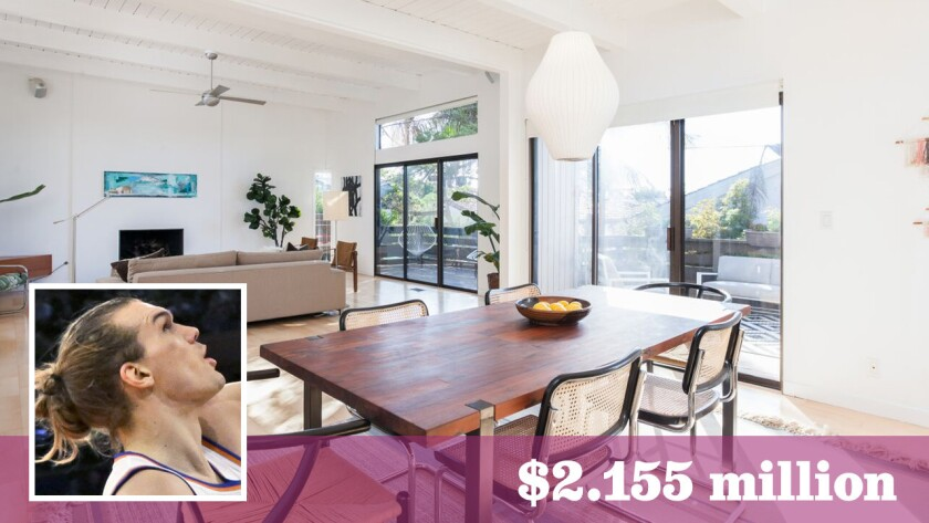 Well-traveled basketball player Lou Amundson has listed his home in Manhattan Beach's Tree Section area for sale at $2.155 million.