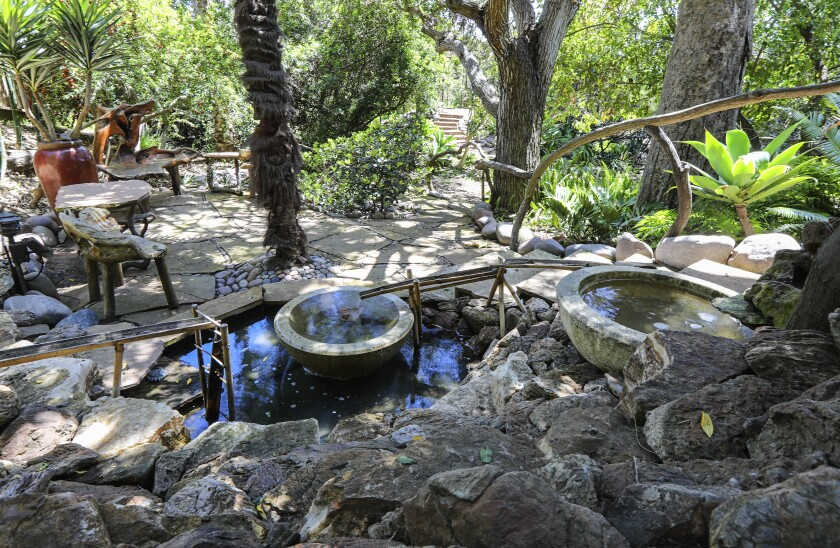 A double-bowl pond with dunker is one of the focal points in the garden of Anne and Jerry Ryan's Point Loma home.
