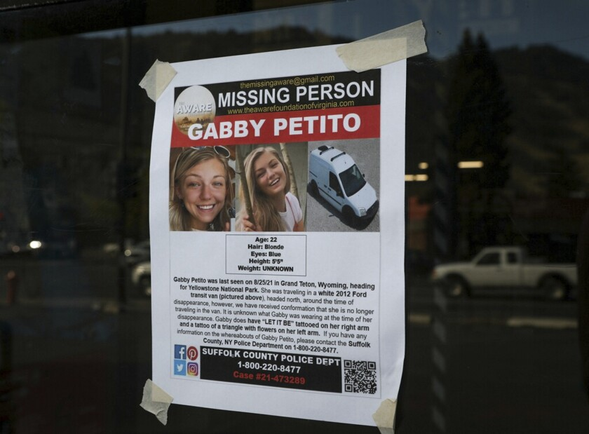 This Thursday, Sept. 16, 2021, photo, shows a Suffolk County Police Department missing person poster for Gabby Petito posted in Jakson, Wyo. Petito, 22, vanished while on a cross-country trip in a converted camper van with her boyfriend. Authorities say a body discovered Sunday, Sept. 19 in Wyoming, is believed to be Petito. (AP Photo/Amber Baesler)