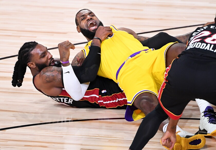 LeBron James and Miami's Jae Crowder get tangled up.