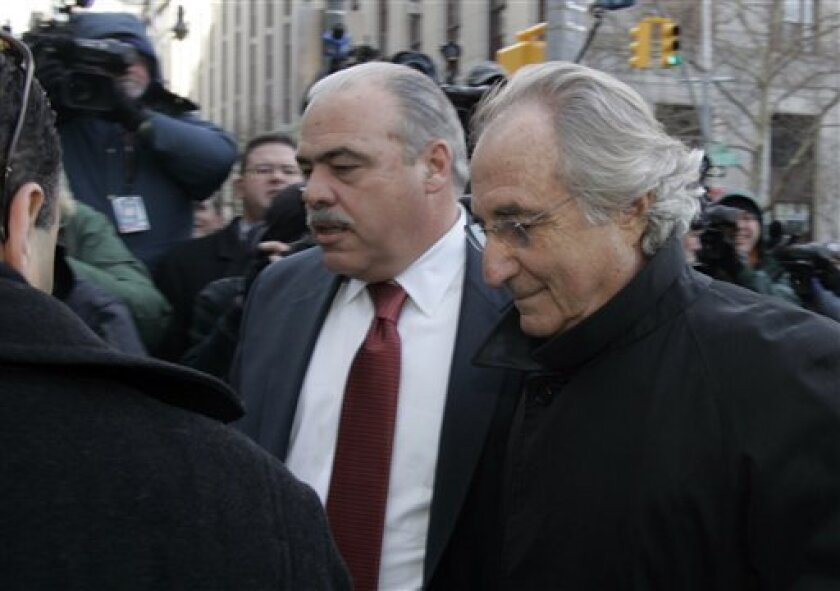 In this Jan. 14, 2009 file photo, Bernard Madoff arrives at Federal Court for a scheduled hearing in New York. Recovering even 10 cents on the dollar might be optimistic for investors who gave their cash to the Ponzi scheme that Bernard Madoff ran. Moreover, they face a years-long process to get a