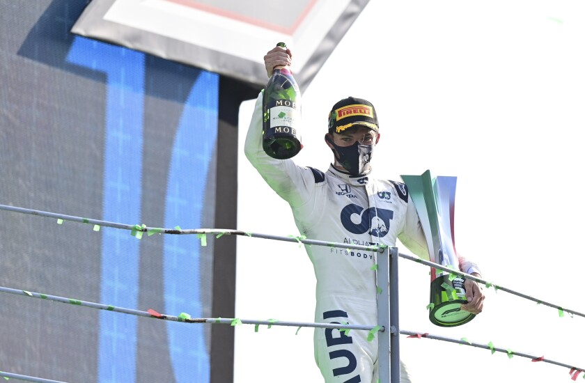 Pierre Gasly celebrates on the podium after winning the Formula One Grand Prix.