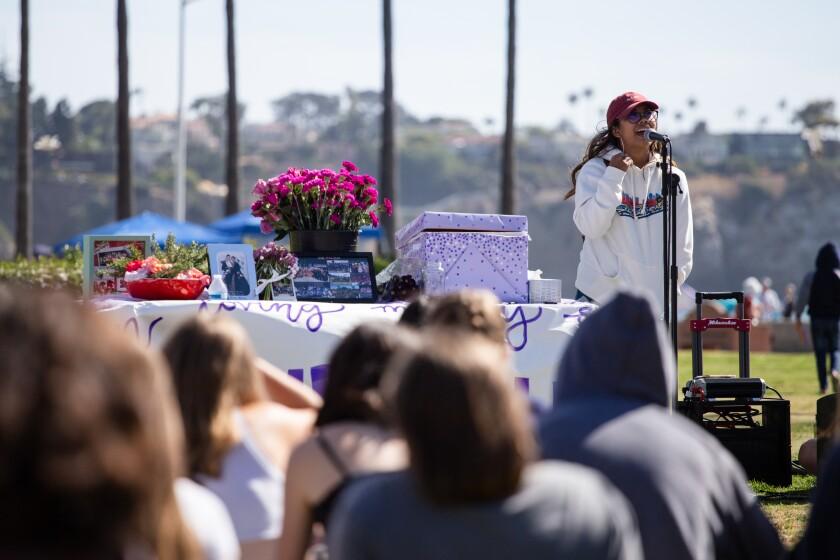 Anna-May Naanos speaks at a memorial honoring Donna Fallon at La Jolla Shores on Tuesday, June 8