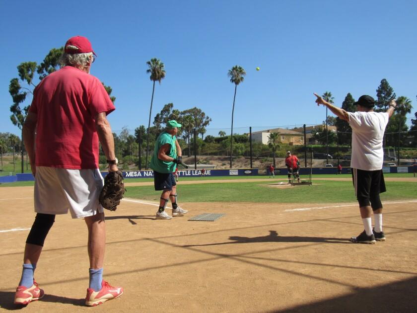 La Mesa Senior Softball Association members play on Wednesday at Kuhlken Field near the La Mesa Recreation Center.