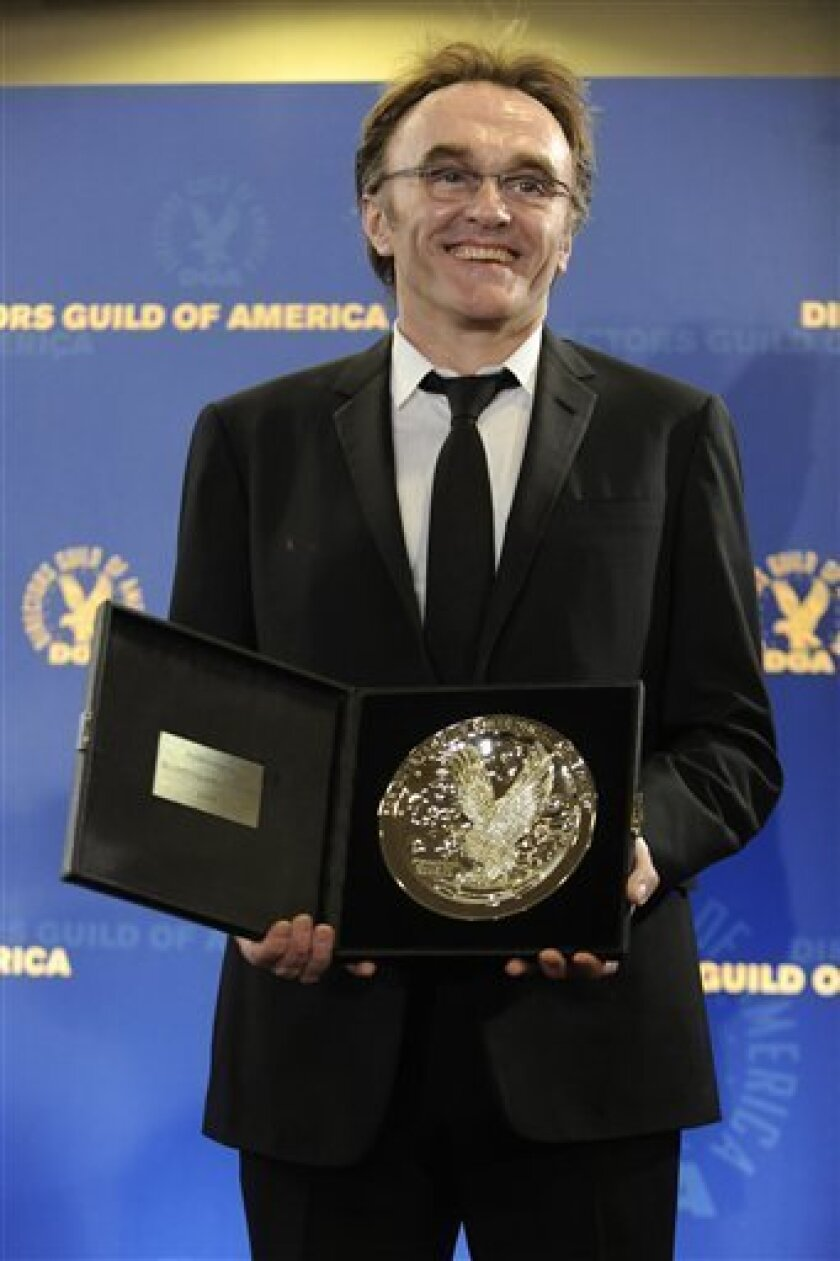 Danny Boyle poses with the award for feature film nomination for Slumdog Millionaire backstage at the Directors Guild of America Awards on Saturday, Jan. 31, 2009, in Los Angeles. (AP Photo/Chris Pizzello)