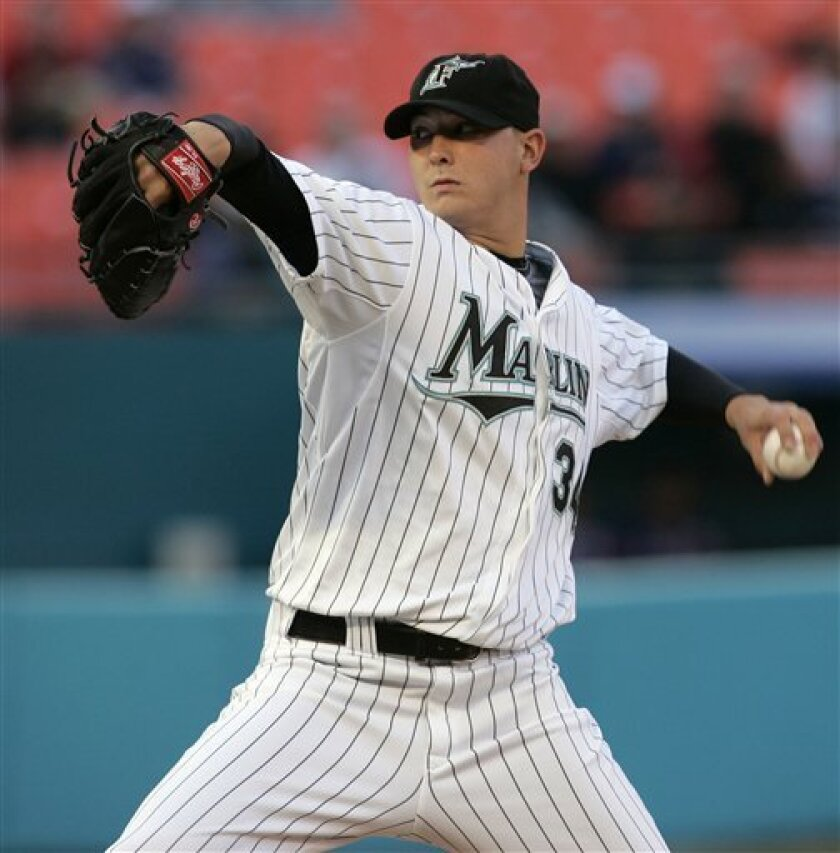 Florida Marlins starter Scott Olsen pitches to the Atlanta Braves during the sixth inning of a baseball game in Miami, Tuesday, April 15, 2008. (AP Photo/J. Pat Carter)