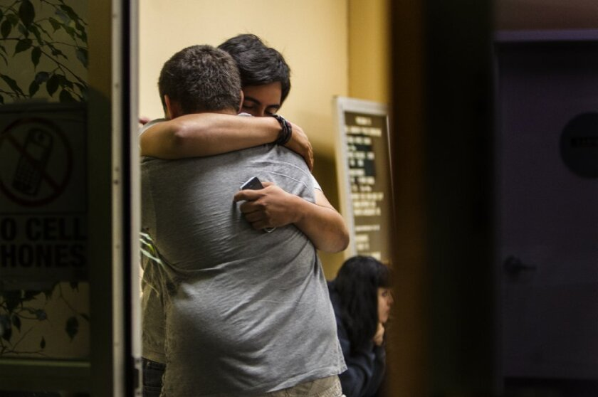 Family members gathered at the Bell Gardens police station where Levette Crespo was detained after Mayor Daniel Crespo's fatal shooting Tuesday.