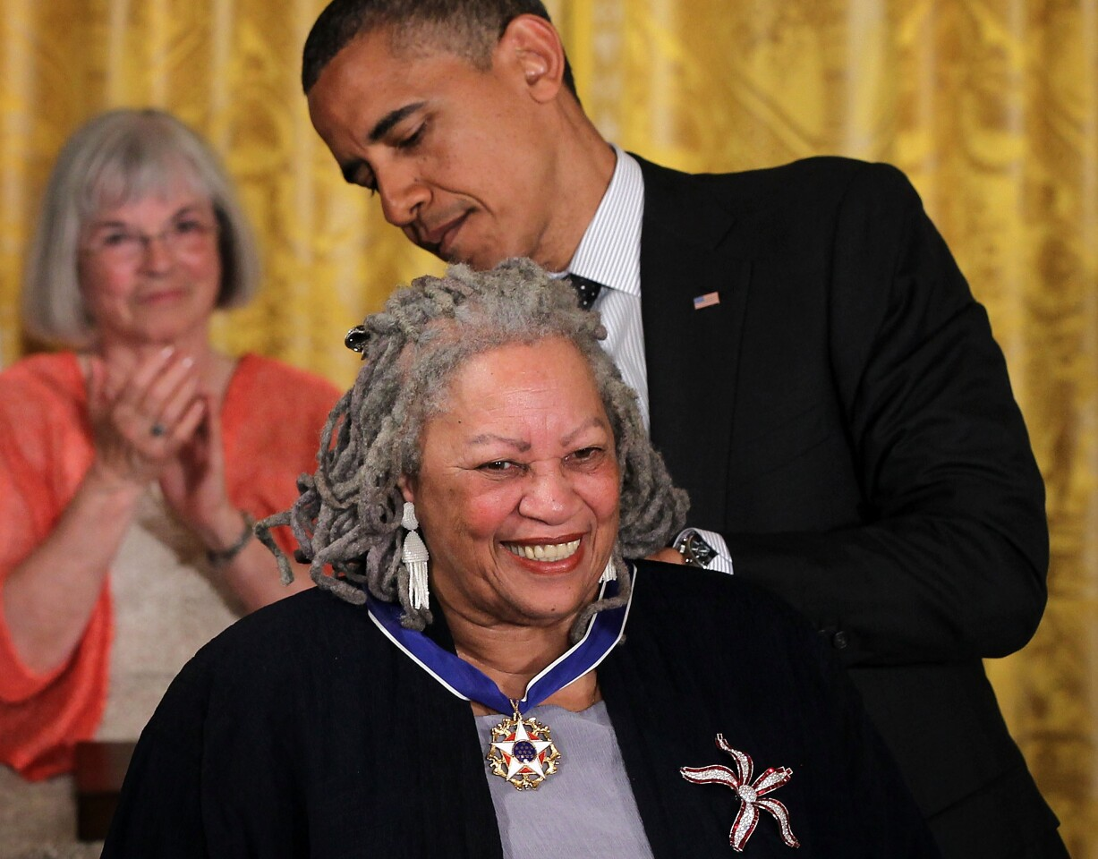 Toni Morrison receives the Presidential Medal of Freedom from President Obama in 2012.