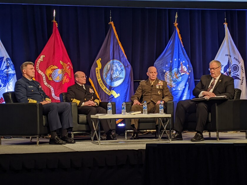Coast Guard Adm. Karl Schultz, left, Navy Adm. Mike Gilday and Marine Corps Gen. David Berger speak with moderator Robert Work at the West 2020 conference in San Diego.