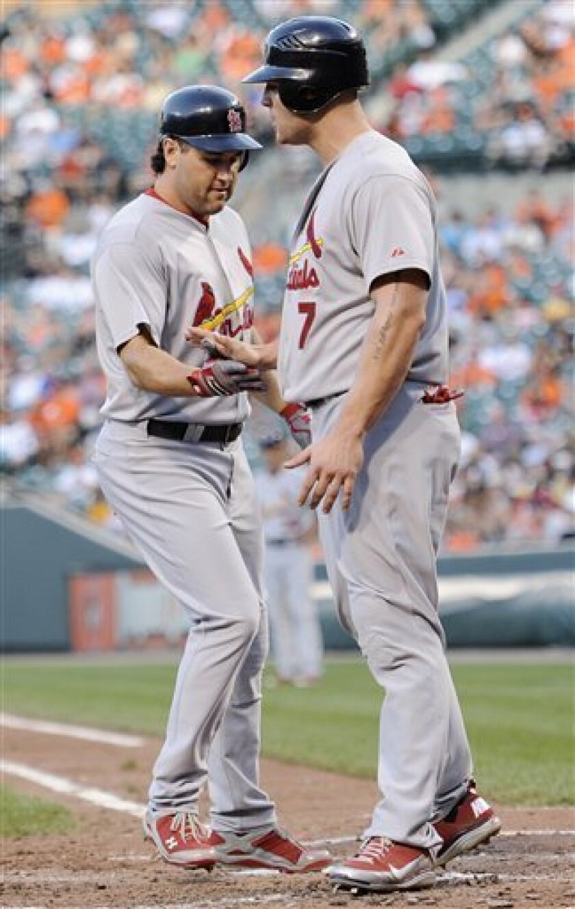 St. Louis Cardinals' Lance Berkman, left, celebrates his two-run home run with teammate Matt Holliday during the third inning of an interleague baseball game against the Baltimore Orioles, Thursday, June 30, 2011, in Baltimore. (AP Photo/Nick Wass)