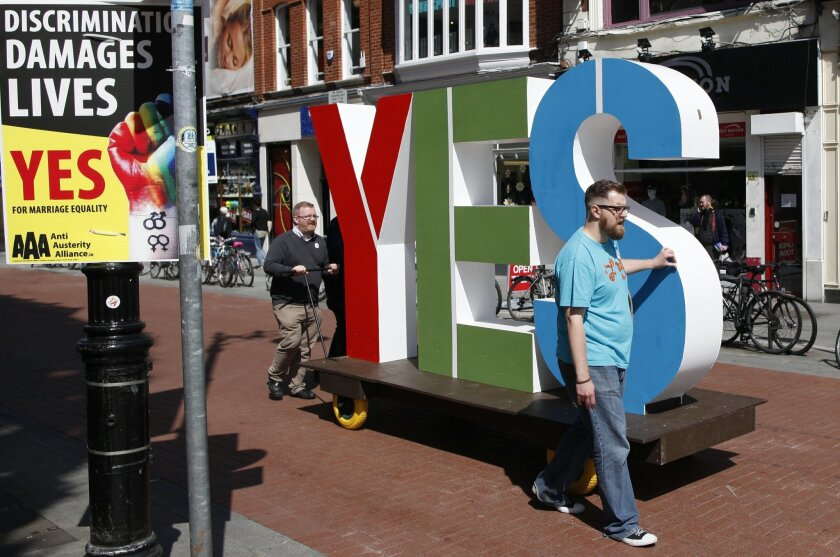 Members of the Yes Equality campaign begin canvassing in the center of Dublin, Ireland, Thursday May 21, 2015. People from across the Republic of Ireland will vote Friday in a referendum on the legalization of gay marriage, a vote that pits the power of the Catholic Church against the secular-minded Irish government of Enda Kenny. (AP Photo/Peter Morrison)