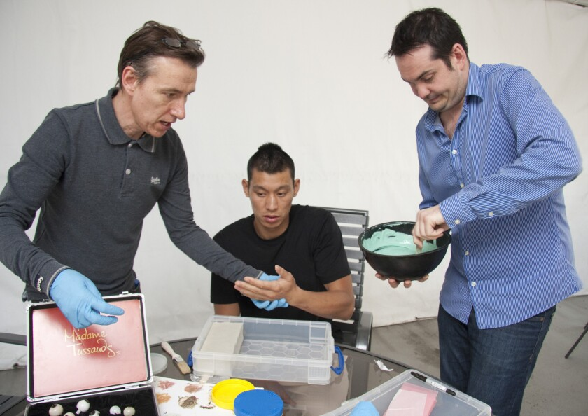 Lakers point guard Jeremy Lin assists in the making of a wax figure of himself.