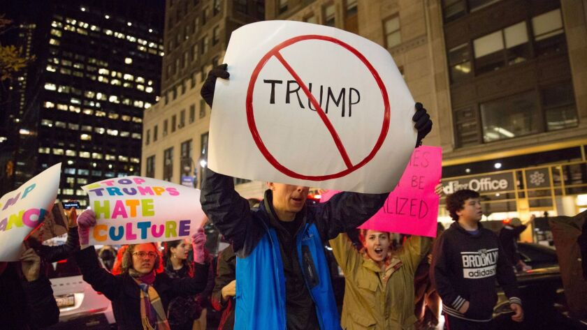 Demonstrators gather outside Trump Tower in Manhattan on Saturday.