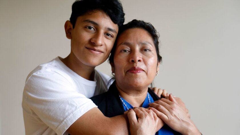 LOS ANGELES, CA January 8, 2018: Portrait of Benjamin Zepeda, 14, with his mother Lorena Zepeda,