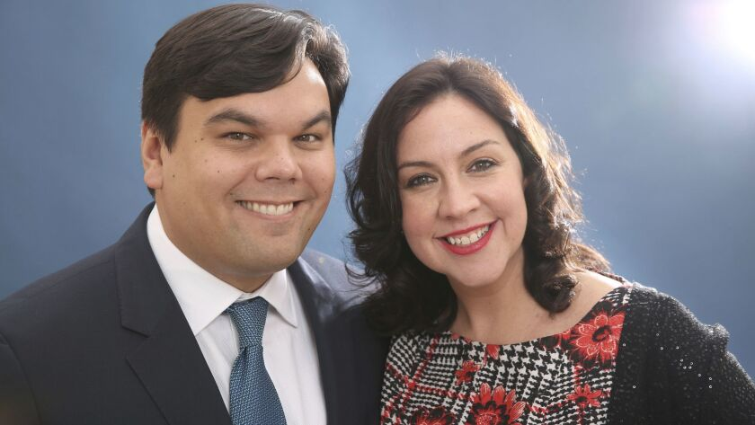 FILE - In this Feb. 10, 2014 file photo, Robert Lopez and Kristen Anderson-Lopez pose for a portrait