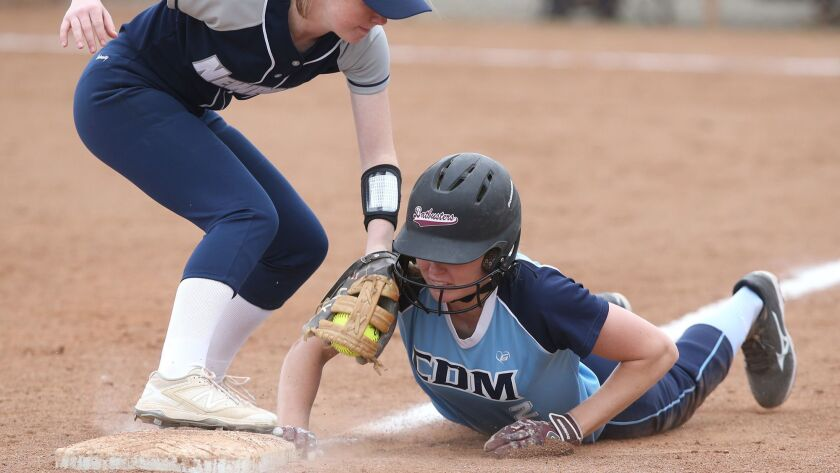 CdM's Audrey Tumbarello dives back to third under the tag of Newport's Lily Larkins during Battle of