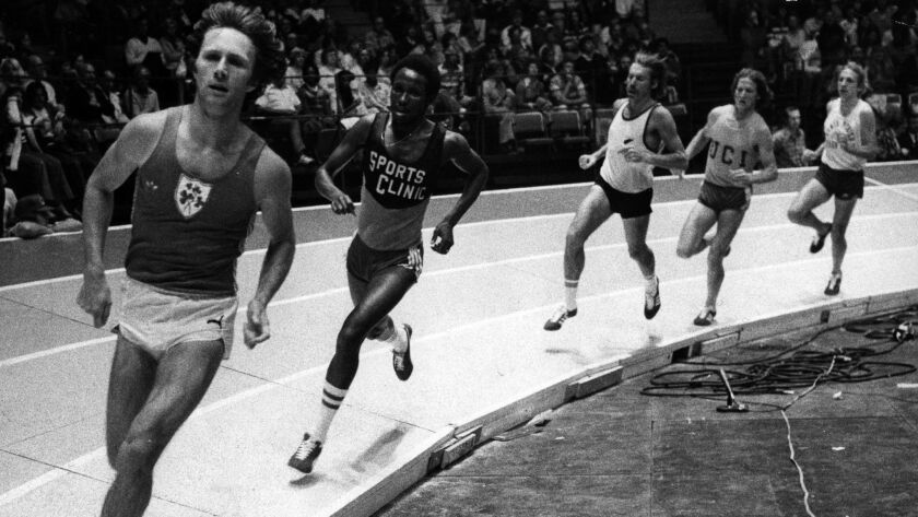 Eamonn Coghlan leads Filbert Bayi en route to winning the mile run at the Indoor Invitational track