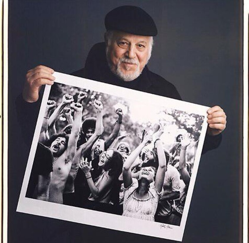 Robert Altman poses with an image from his book 'The Sixties: Photographs.'